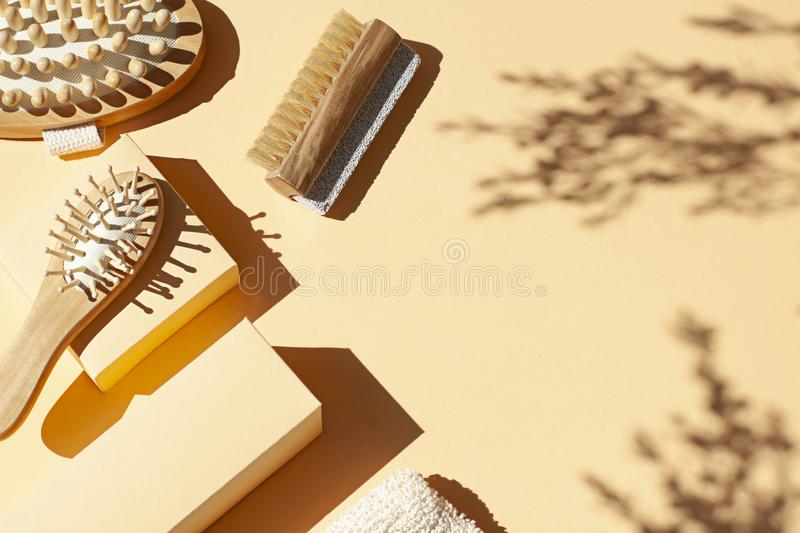 Bathroom, spa accessories concept flat lay on the beige background. Top view frame. With hairbrush , nailbrush with pumice stone, bath mitt and massaging brush stock photo