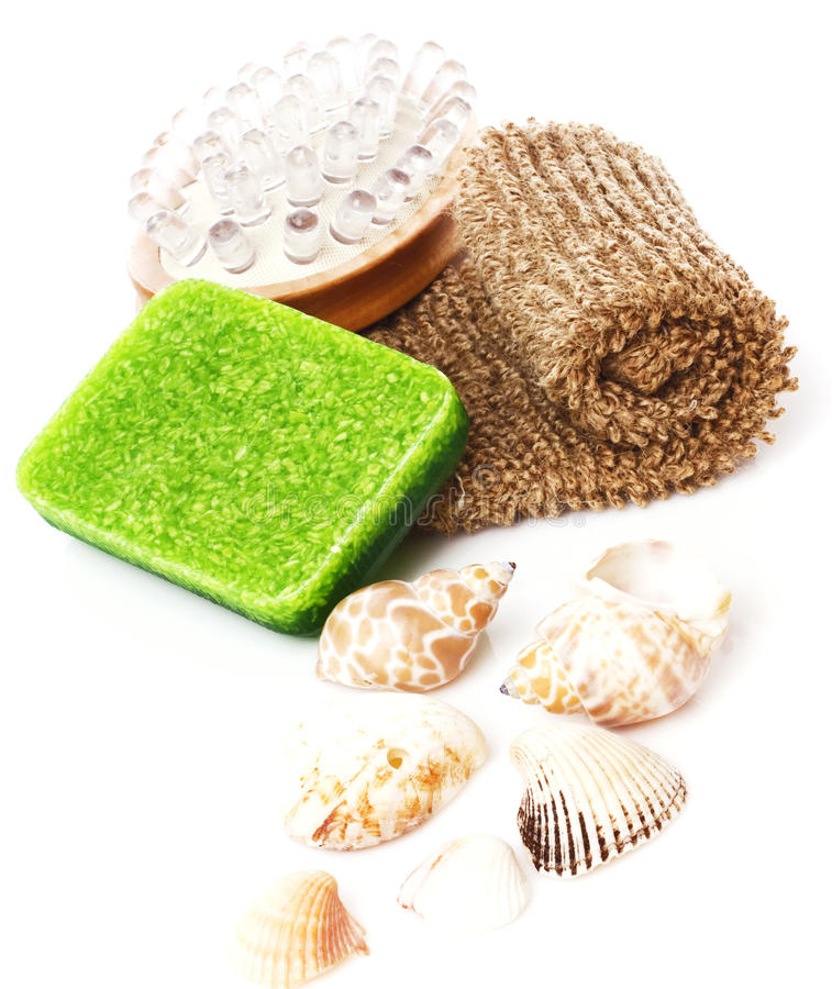 Bathroom spa composition. Bathroom composition with natural soap, bast whisp and seashells, isolated stock photos