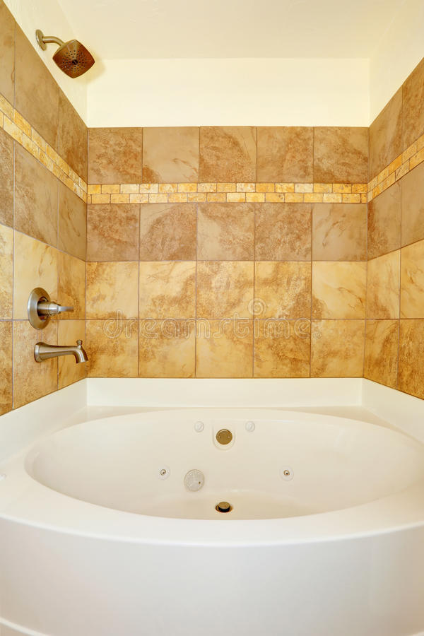 Bathroom With Tile Wall Trim And White Bath Tub Stock
