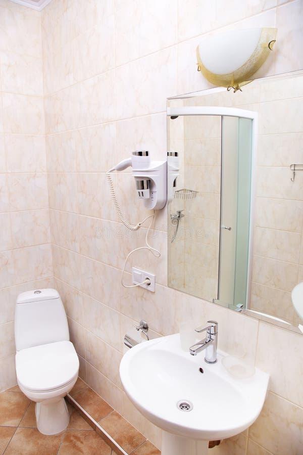 Bathroom with toilet, washbasin, mirror. Clean fresh bathroom in the hotel. Refreshing room royalty free stock photos