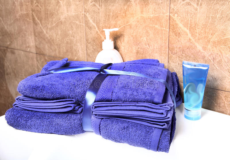 Bathroom towel. With face wash tube stock image
