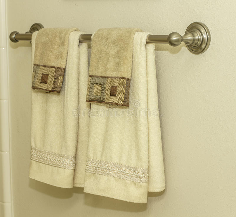 Bathroom Towel Rack. A bathroom towel rack hanging on a wall royalty free stock photo