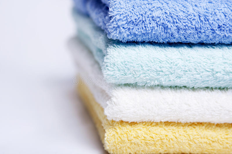 Bathroom towels. Some nicely colored clean and soft bathroom towels stock images