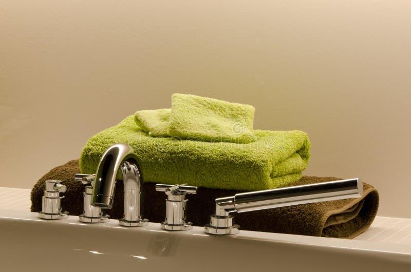 Bathroom Towels. Laying beside a bath royalty free stock photos