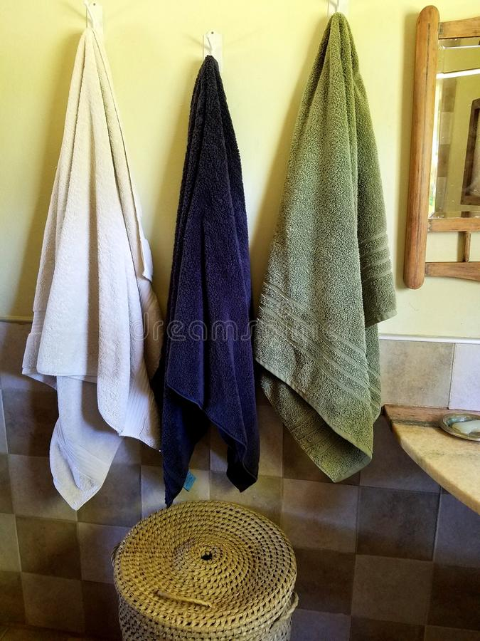 Bathroom towels. And basket detail royalty free stock images
