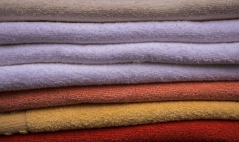 Bathroom towels closeup. Shocase. A stack of colorful towels in a store royalty free stock photos