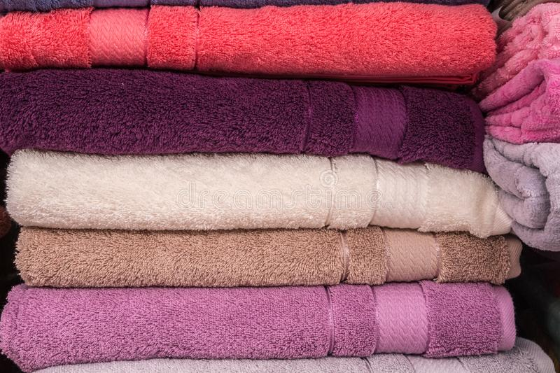 Bathroom towels closeup. Shocase. A stack of colorful towels in a store stock image
