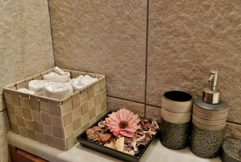Bathroom with towels, flowers and care creams. Beautiful background stock images