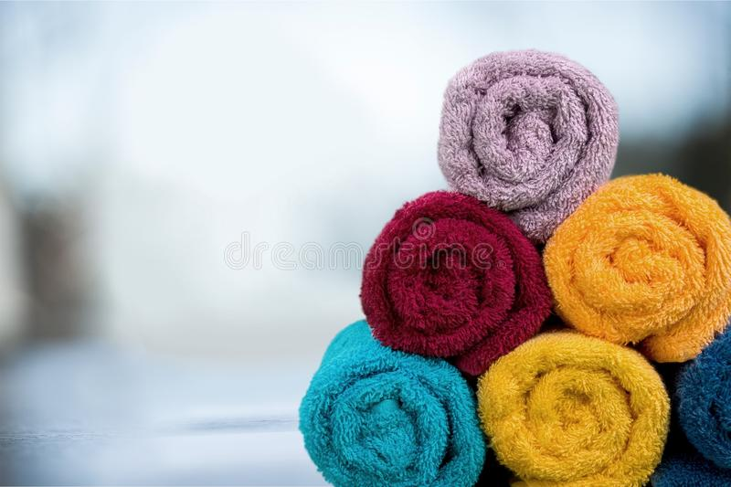 Bathroom Towels. Laundry Textile Health Spa Rolled Up Beach Towel Stack stock photo