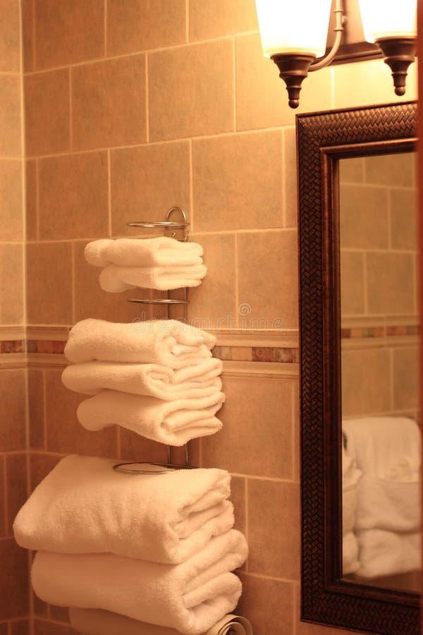 Bathroom Towels. Modern Bathroom White Towels on racks royalty free stock photos