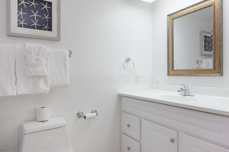 Bathroom with towels. Stock image of a small bathroom with towels stock photo