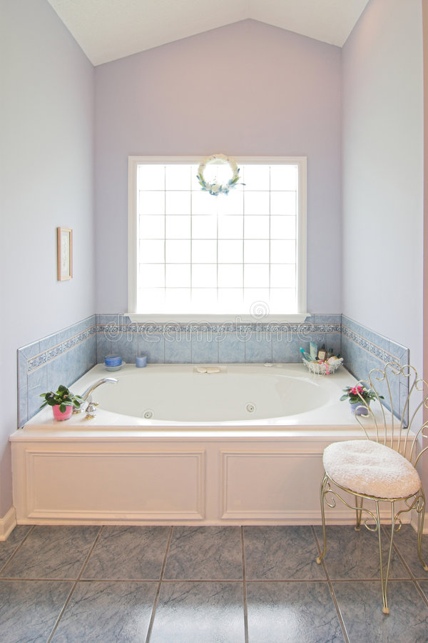 Bathroom with whirlpool. And large window royalty free stock photos