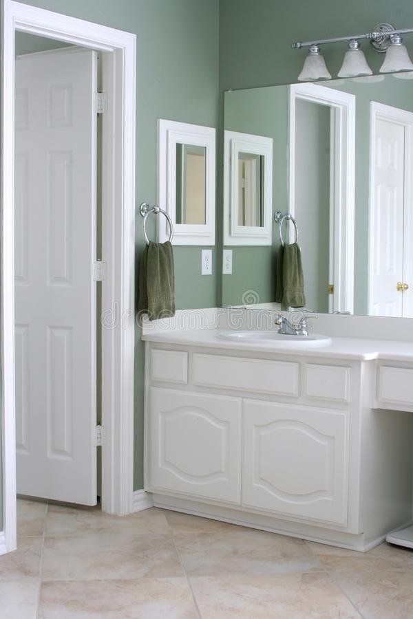 Bathroom with white cabinets and trim stock photos