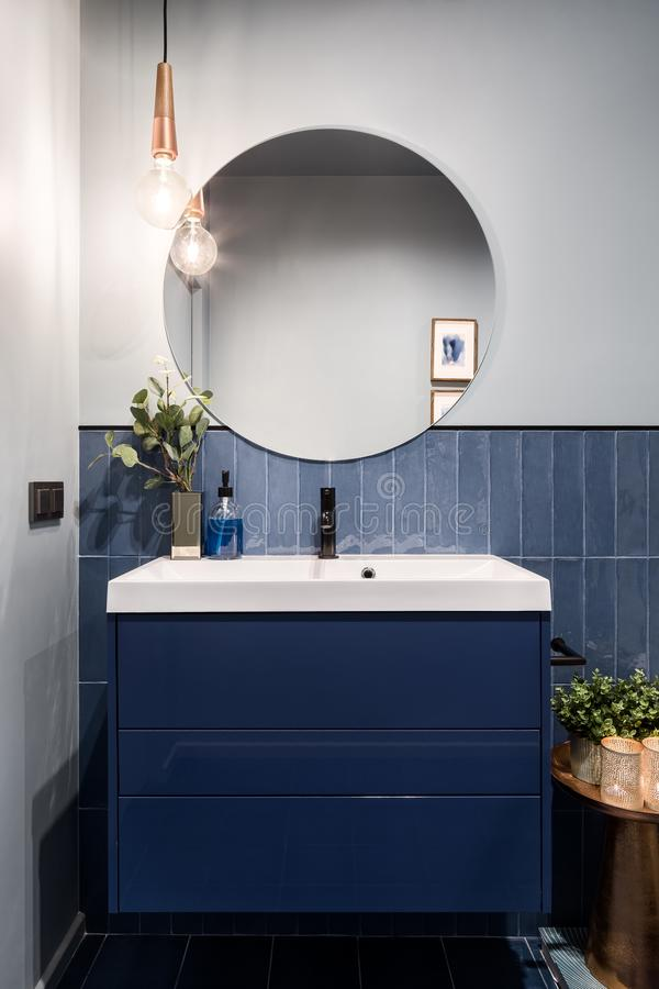 Free Bathroom With Dark Blue Cabinet Royalty Free Stock Photo - 146163785