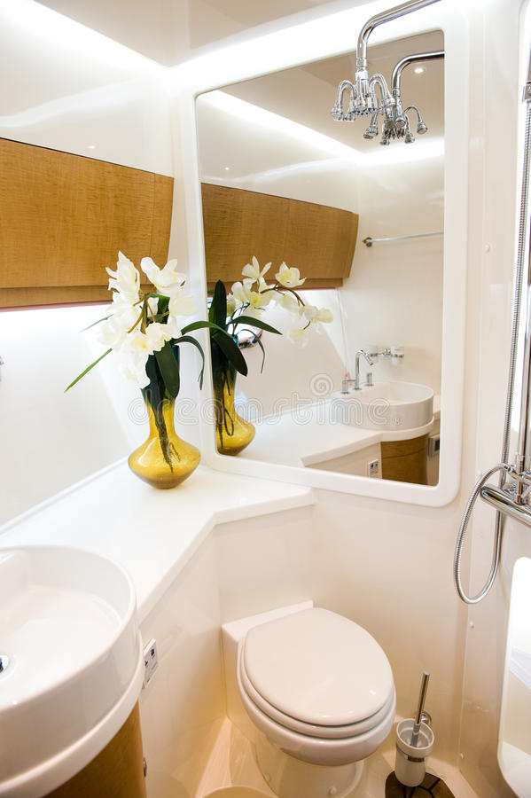 Bathroom in yacht. A view of a bathroom in yacht stock photo