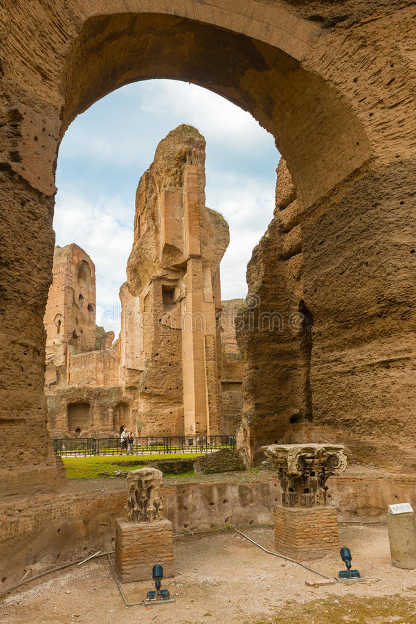 The Baths of Caracalla in Rome, Italy. Rome, Italy - September 18, 2014: Tourists visiting Baths of Caracalla. It were the second largest Roman public baths royalty free stock photo