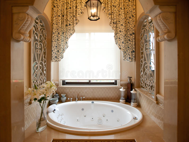 Bathtub. A white round Bathtub.Retro curtain with beatiful flower stock images