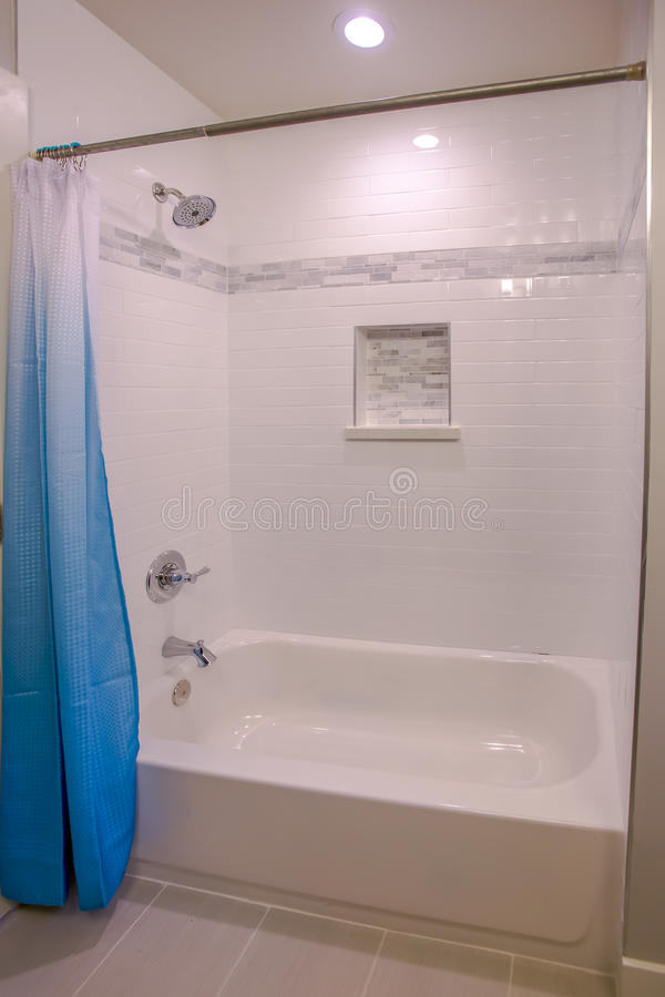 Download Bathtub And Shower With Bright Blue Curtain And White Tiles In San  Diego Home Southern
