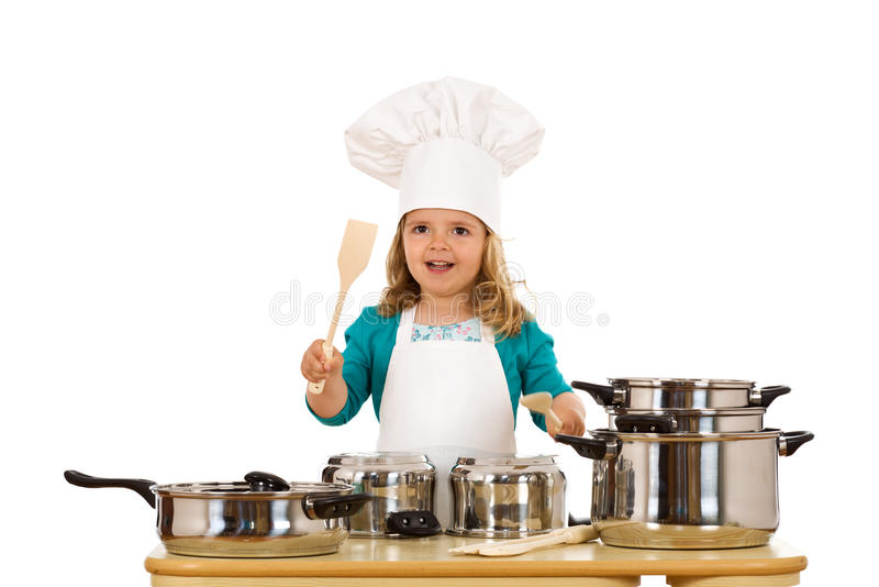 Batida do cozinheiro chefe da menina nos potenciômetros imagem de stock royalty free