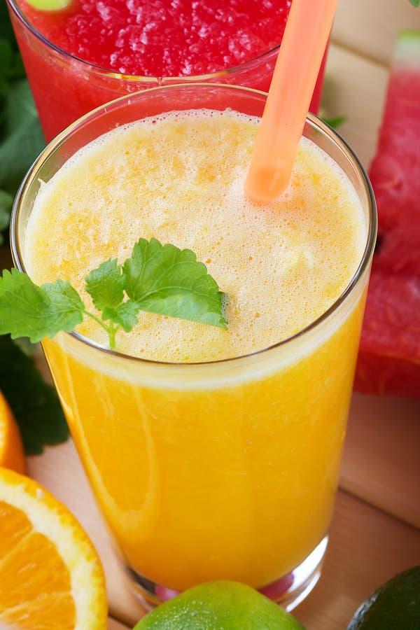 Batidos da laranja e da tangerina foto de stock royalty free