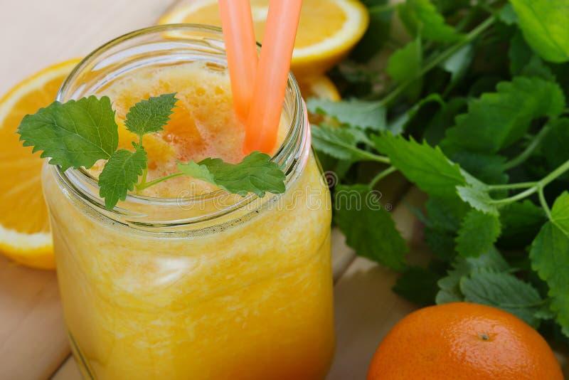 Batidos da laranja e da tangerina fotos de stock royalty free