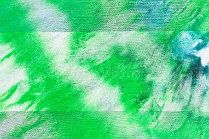 Batik - abstract green striped pattern on silk. Fabric royalty free illustration