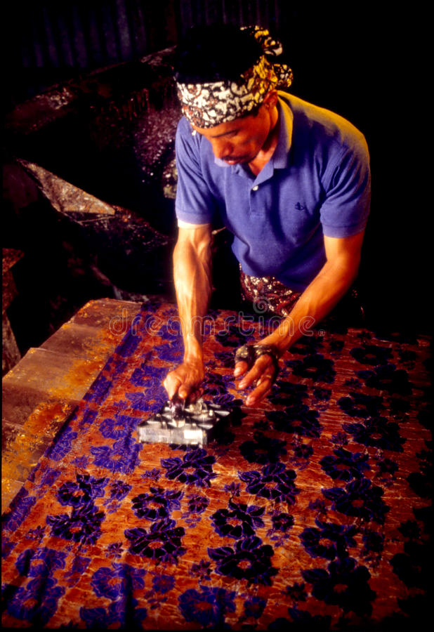 Batik Block Stamping. Batik is a cloth that is traditionally made using a manually putting hot wax onto pre-carved wooden or copper block (called a chop) and stock photography
