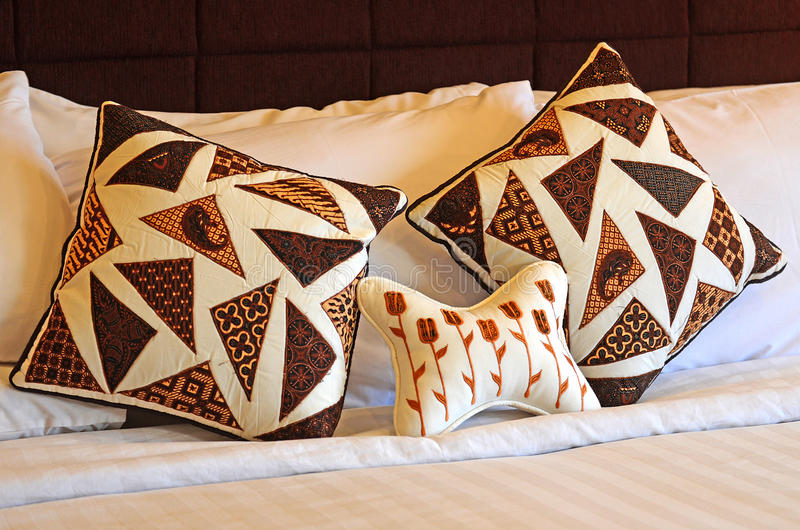 Batik. Bolster pillow Indonesian batik cloth wrapped royalty free stock photography