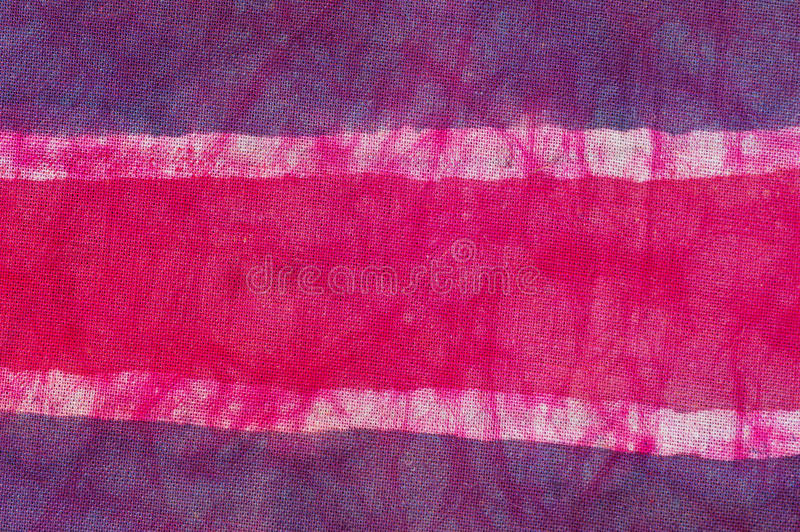 Batik Cloth Background. Batik cloth with purple white and pink stripes royalty free stock image