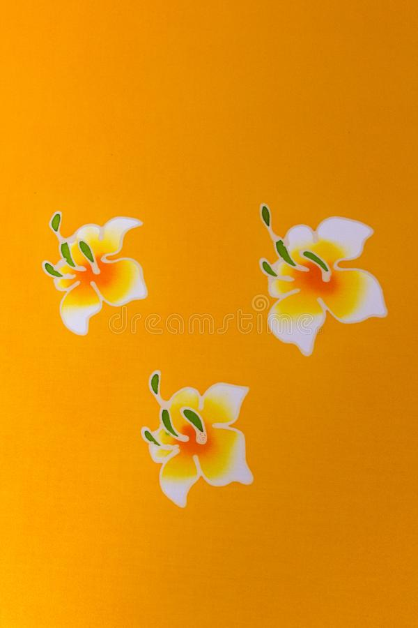 Batik Cloth. Painted flowers on yellow Batik cloth, handmade royalty free stock images