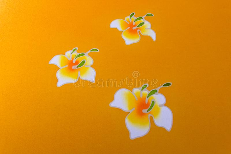 Batik Cloth. Painted flowers on yellow Batik cloth, handmade royalty free stock photos