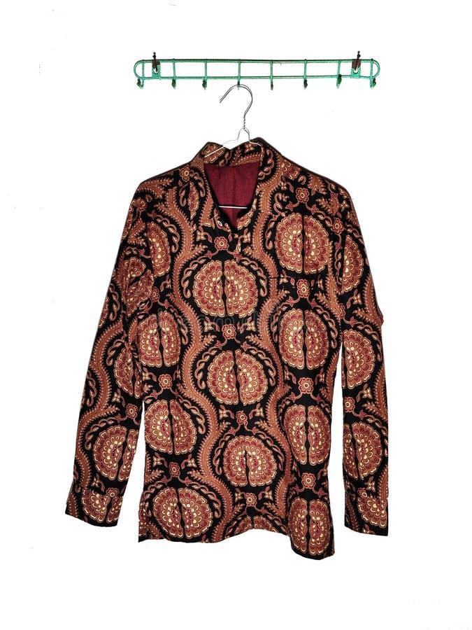Batik clothes hanging isolated on white stock photo