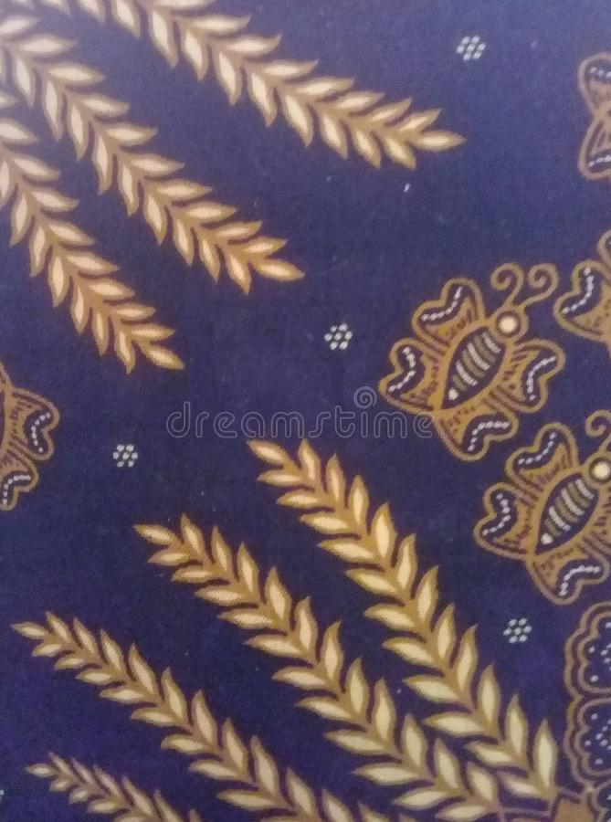 Batik leaf wheat and bees stock photos