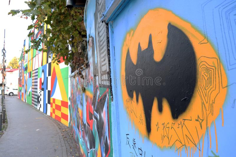 Batman Bat Signal Graffiti. The Bat-Signal is a distress signal device appearing in American comic books published by DC Comics, as a means to summon the royalty free stock photo