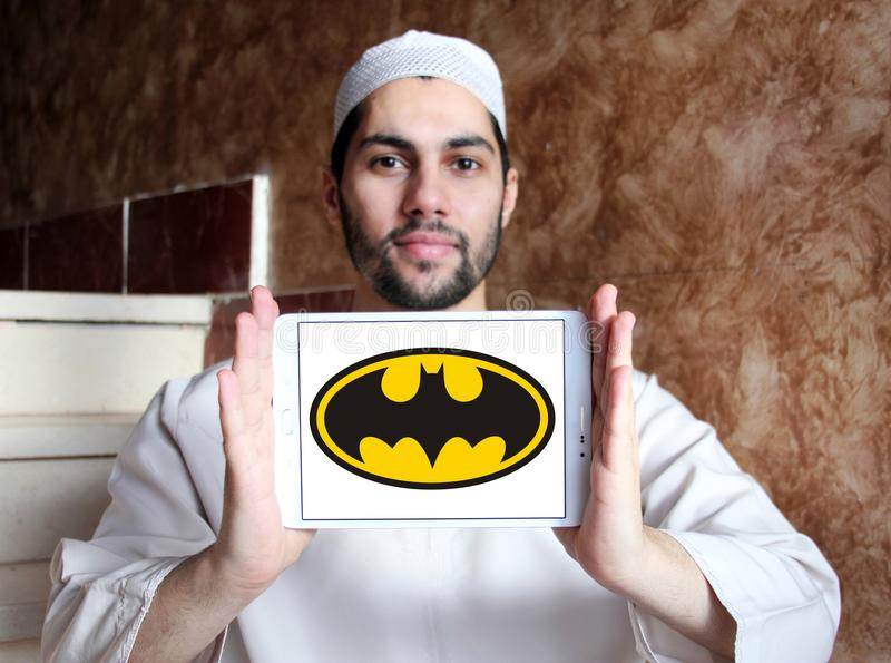 Batman logo. Logo of Batman on samsung tablet holded by arab muslim man. Batman is a fictional superhero appearing in American comic books published by DC Comics royalty free stock photos