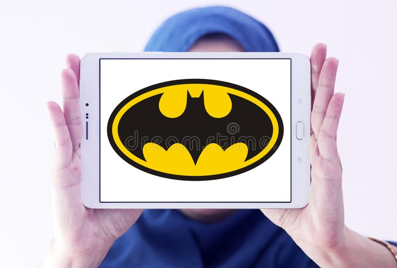 Batman logo. Logo of Batman on samsung tablet holded by arab muslim woman. Batman is a fictional superhero appearing in American comic books published by DC stock photos