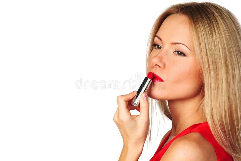Batom do vermelho da mulher fotografia de stock