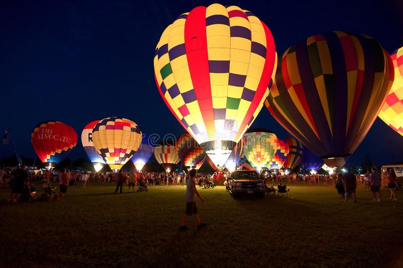 People prepare for the glowing of the balloons at the annual Hot Air Balloon Festival royalty free stock image