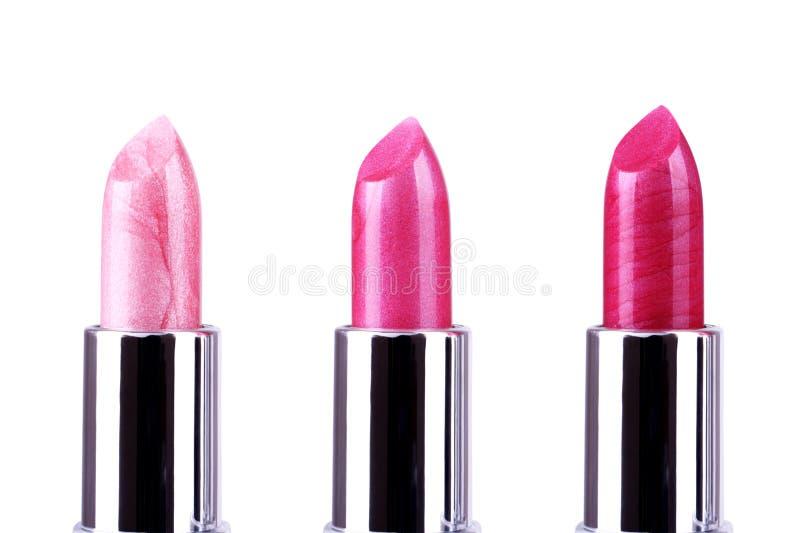 Batons cor-de-rosa no branco fotografia de stock royalty free
