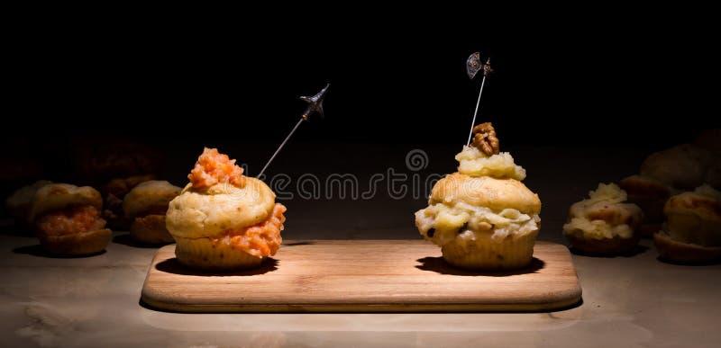 Battaglia dei muffin fotografie stock