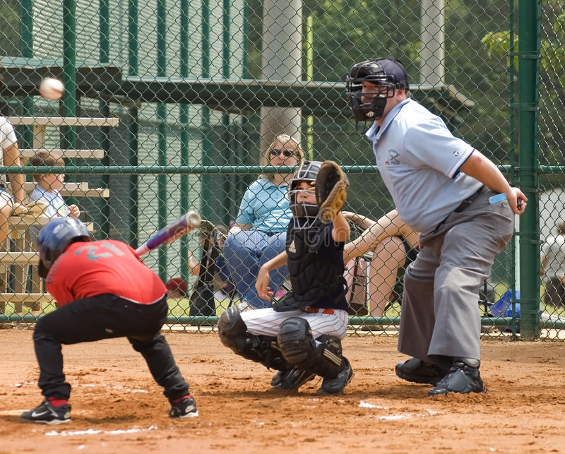Batter Dodging a Ball in Little League Baseball stock image