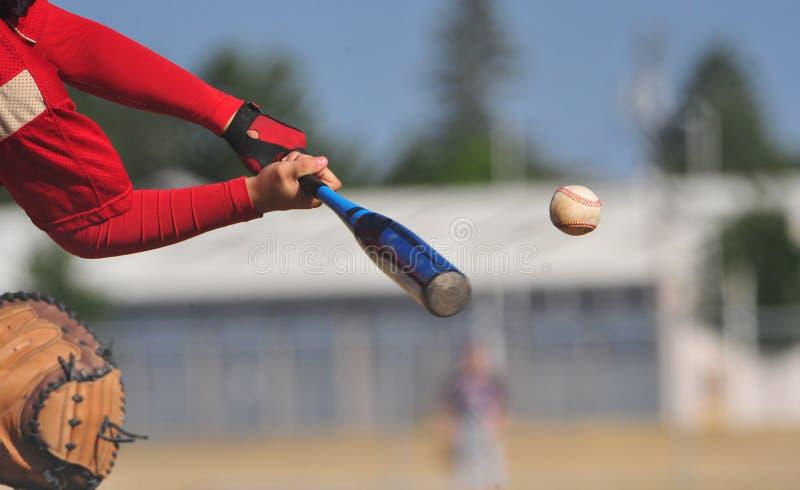 Batter hits the ball stock image