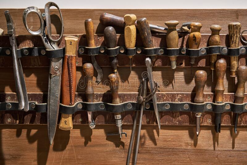 Closeup view at instruments for leather sewing stock images