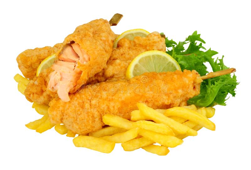 Battered salmon fish fillets on wooden skewers with French Fries. Isolated on a white background stock photo