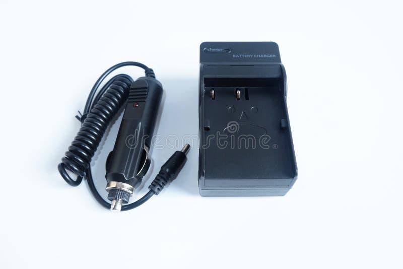Batteria del caricatore di potere dell'adattatore della macchina fotografica con il portatile del caricatore dell'automobile su b immagini stock