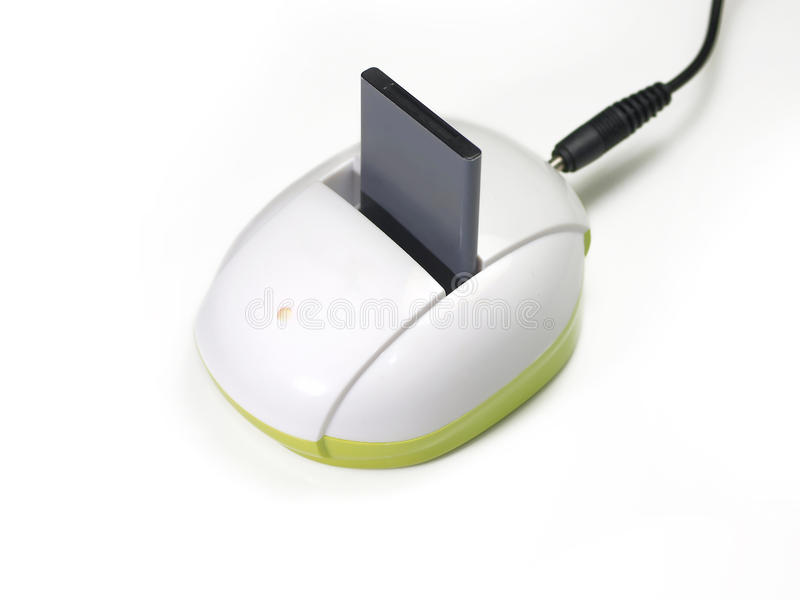 Batteria e caricatore del microtelefono immagine stock libera da diritti