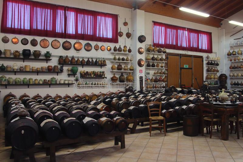 Differents `Batterie` of old casks for the production of original Balsamic vinegar in Castelnuovo di Modena and old ceramic jars. `Batteria` is a series of royalty free stock photo