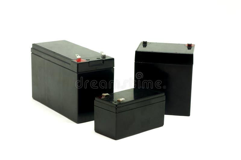 Batterier som isoleras på vit royaltyfri bild