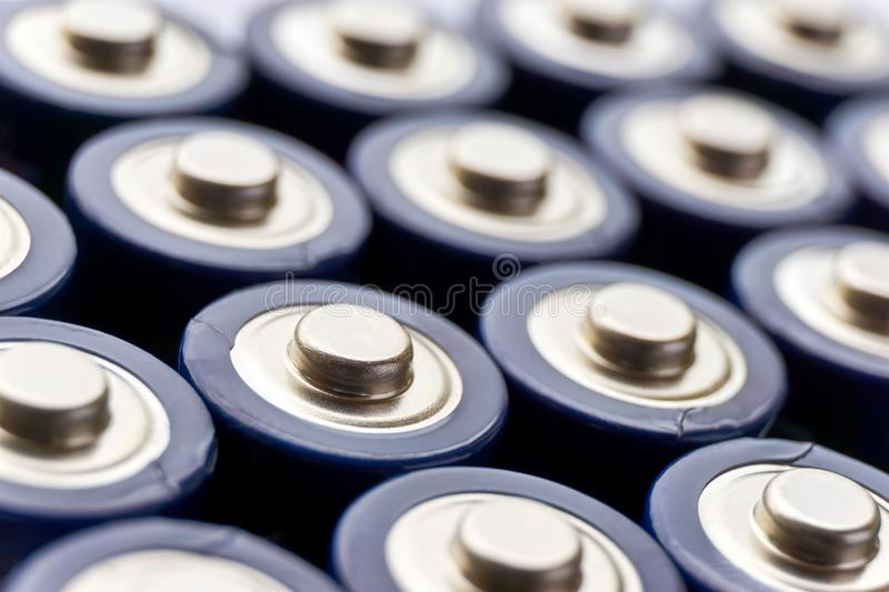 Positive poles of blue AA batteries royalty free stock image