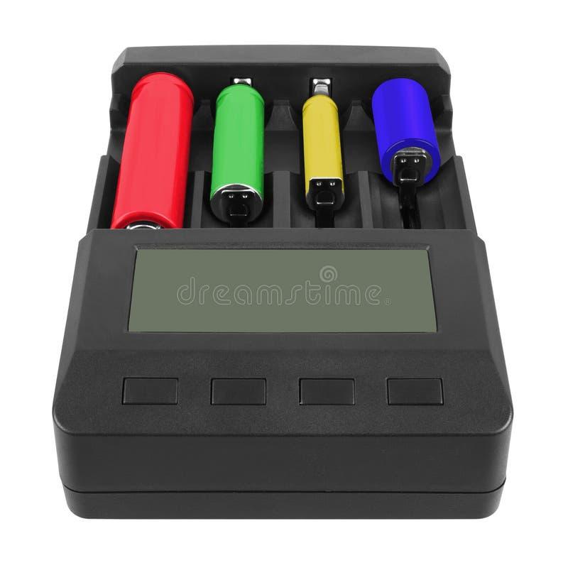 Batteriuppladdare med laddade batterier royaltyfria foton